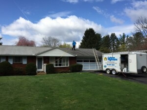 During Roof Cleaning by Grime Fighters in Lehigh Valley, PA