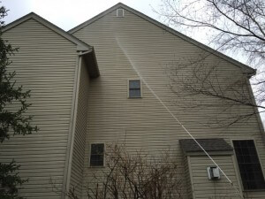 Grime Fighters Cleaning the Siding on a 3 story house in Coopersburg, PA